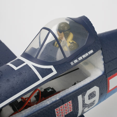 Removable hatch and pilot figure allow for easy access to battery and radio equipment