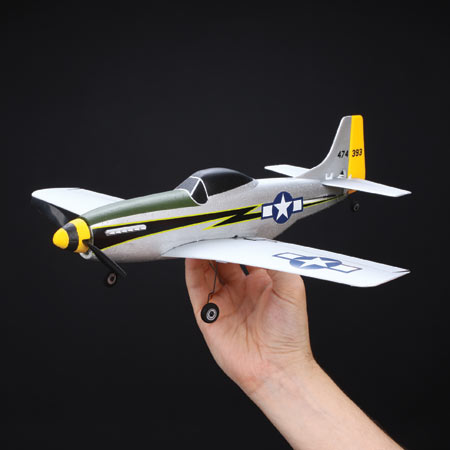 The P-51D's sharp looking paint scheme was inspired by Mustangs that flew